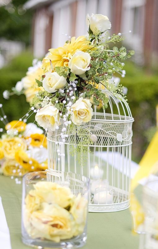 Birdcage Centerpieces/ pearl sprays and roses, bottom lace trim and smaller roses