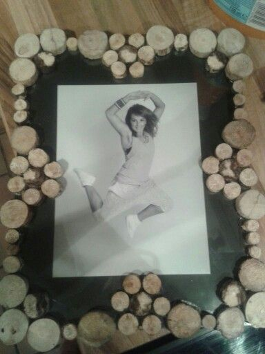 Frame decorated with wood.