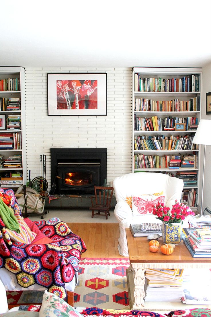 Modern colorful living room with two bookshelves