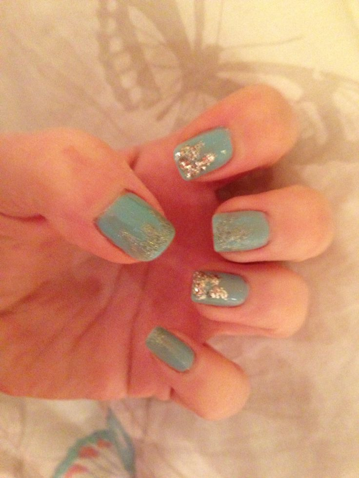 Pale blue nails with glitter