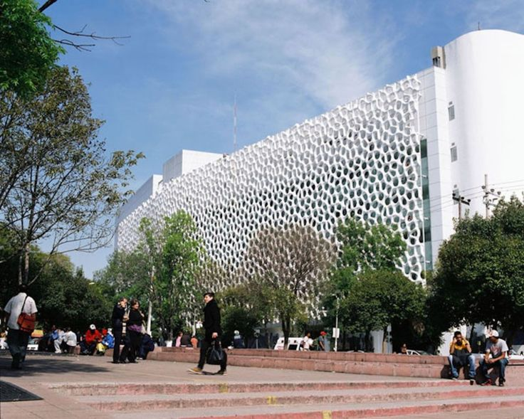 functional and beautiful –  smog-sucking facade on the Hospital Manuel Gea Gonzalez in Mexico City. The honeycomb-like facade is made up of Elegant Embellishments' prosolve370e modules that give the hospital a fashionable touch, filters air pollutants, and prevents unwanted solar gain. The geometric tiles are coated with superfine titanium dioxide, which, when activated by ambient daylight, can neutralize emissions and other toxins.
