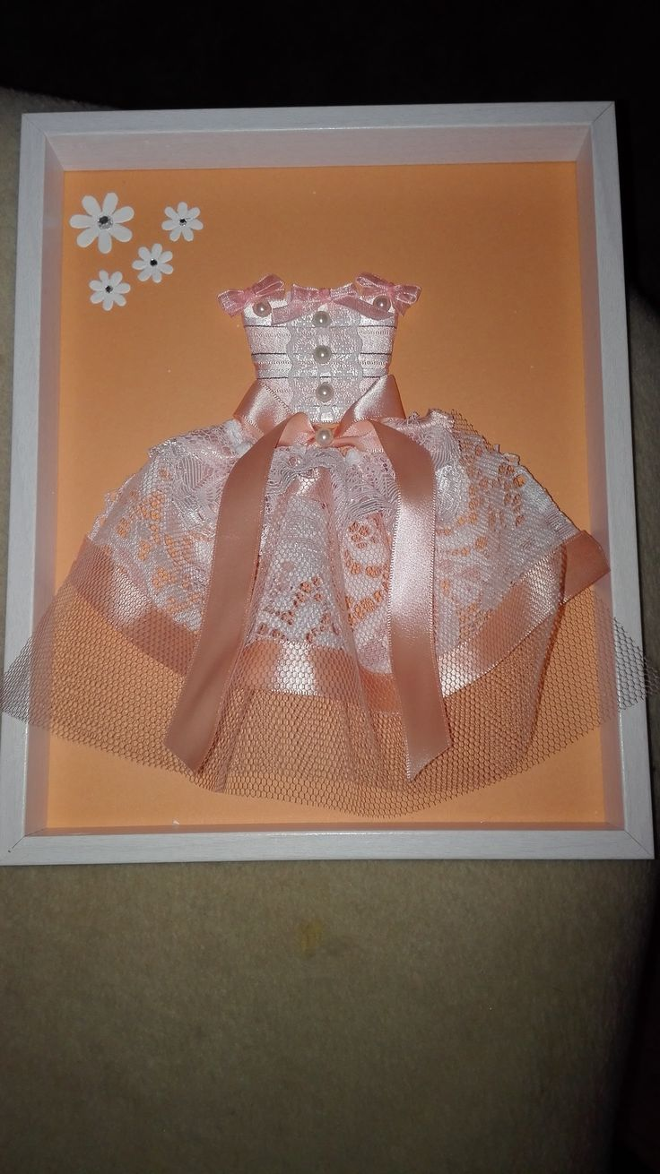 Peach paper doll dress in frame