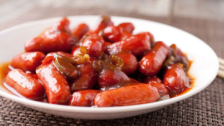 A quick and tasty appetizer with slow-simmered mini hot dogs in a slightly sweet and tangy bourbon sauce.