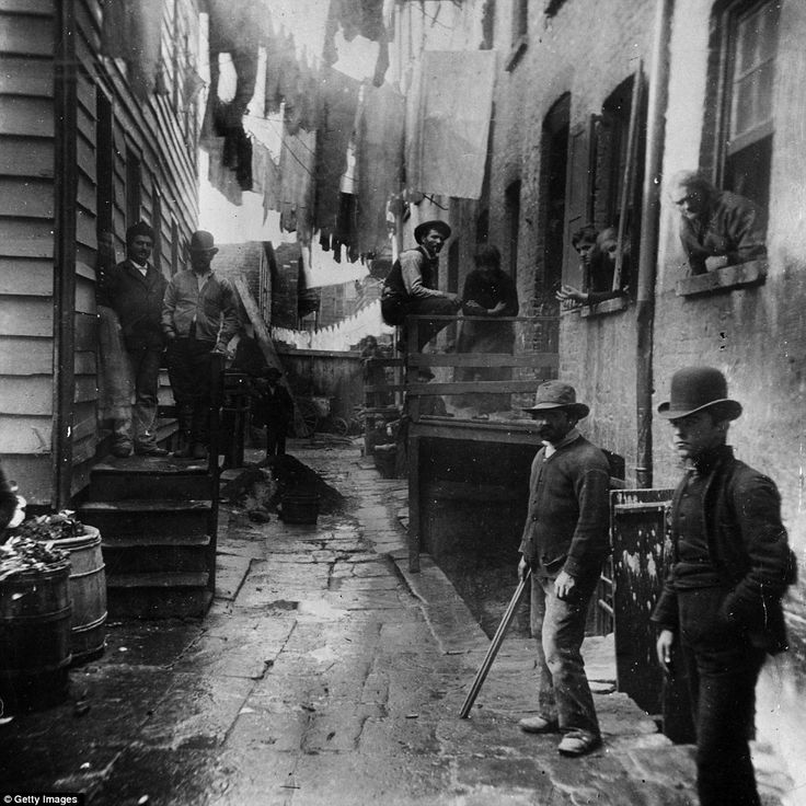 Rhiis 1887: a group of men loiter in an alley known as 'Bandit's Roost' off Mulberry Street