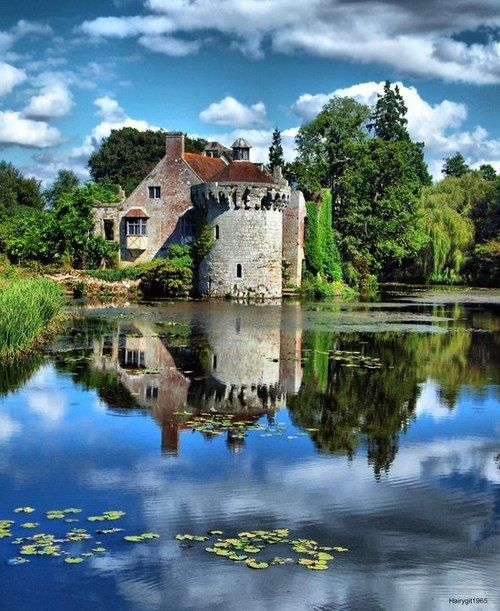 Scotney Castle, Kent, England. Scotney Castle is an English country house with formal gardens south-east of Lamberhurst in the valley of the River Bewl in Kent, England. It belongs to the National Trust