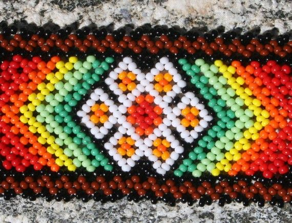 I absolutely love the design on this piece. Sometimes using Delica seed beads doesn't work, and this is one case of that. I love it! <3  Two White Peyote Chaquira Bracelet Cheerful inspiration
