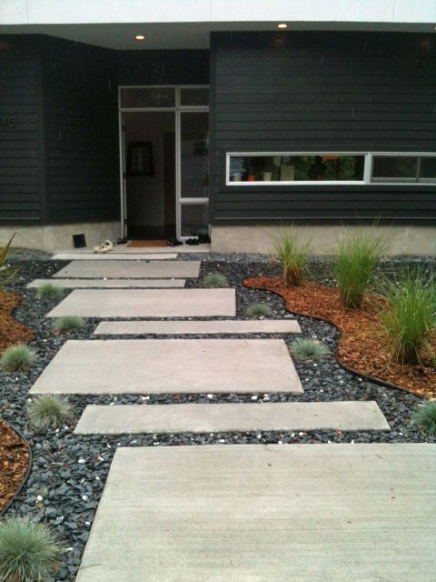 Walkways enhance home's curb appeal | www.ajc.com. ...  George Vail designed the staggered front walk his Roswell home. Vail calculated the sizes and layout of the concrete pavers, which were poured on site. Mixing pavers with slate chip allows rain water to be absorbed back into the ground.