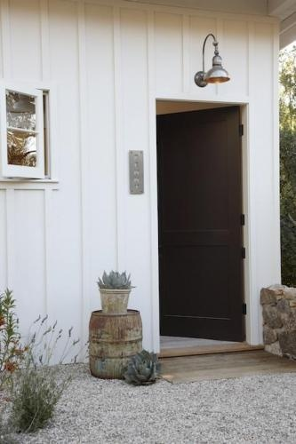 like the board and batten siding and the pea gravel