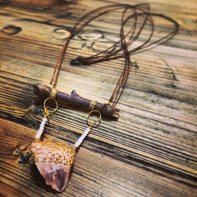 """@Somsri's photo: """"Feature necklace: wire woven rose quartz suspended from wood."""" #jewellery #handmade #jewelry #necklace #crystals #somsri #gemstone #rosequartz #roughcut #wood"""