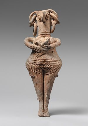 Marija Gimbutas called these types of figurines Bird Goddesses, this one is holding an infant - Syrian, 1450-1200 BCE