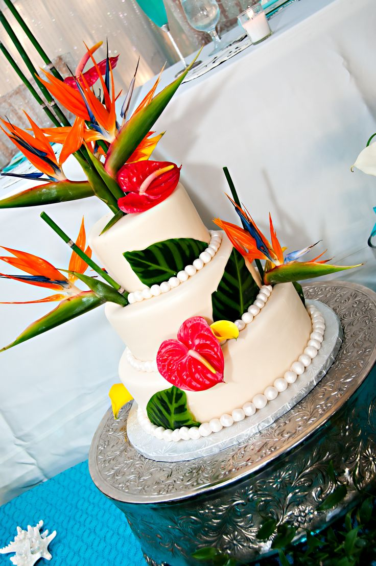 Tropical Wedding Cake. He does love his Birds of Paradise!!! Maybe find a way to incorporate the ocean into it too some how
