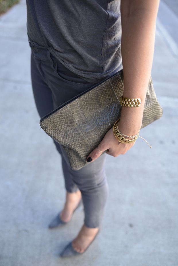 Cupcakes and Cashmere | Grayed Out - gray tee, gray skinny jeans, gray toned python clutch