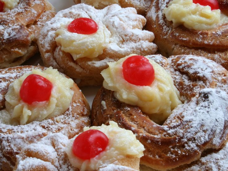 Zeppoles : In Southern Italy, the traditional zeppole is fried until golden brown and topped with ricotta cheese or pastry cream. The texture is soft and airy like a beignet, and the inside is fluffy and often fruit-filled like a Berliner.  Photo courtesy ofNemosdadvia iStock