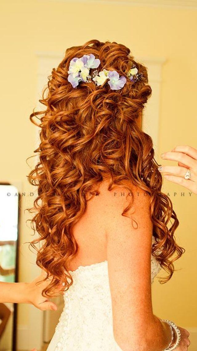 Super cute curly hair do.