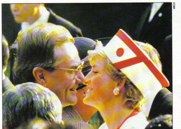 Diana, Princess of Wales in Japan, December 1990. She paid tribute to the host country by wearing the colors of their flag, as well as the image of their symbol of the rising sun.