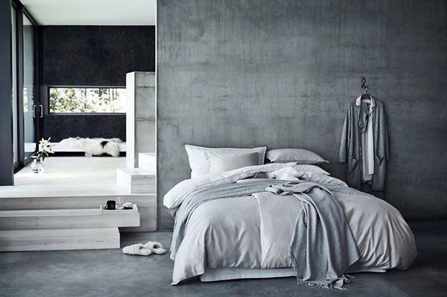 This concrete bedroom leading into an ensuite looks oh so inviting  #bedroomdecor #bedroom #bedroominspo #bedroominspiration #bedroomideas #bedlinen #scandinavian #scandi #scandihome  #homedecor #bedroomdesign #bedrooms #bedroominspo #bedroomstyle #bedroomstyling credit @hm_home