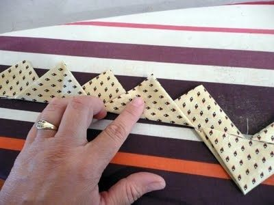 Prairie points with one continuous strip of fabric. Great tutorial on how this is done. From Pieces of Rana's Life. Now you're talking!.