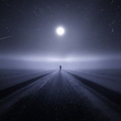 Alone on a moonlit road