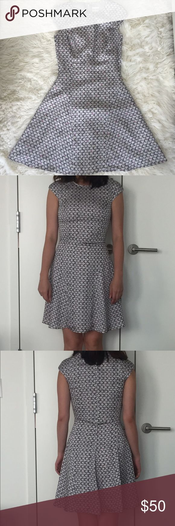 """New Reiss printed A-lined dress size 2 Elegant and classic Reiss printed dress in US size 2. It is great for work and date. I'm 5""""5 and 125 lbs. Bust 25"""". Waist 27"""". Bottom 35"""". I love this dress but it is a bit too small on me. It will look good on someone who is a bit smaller than me. Reiss Dresses Midi"""