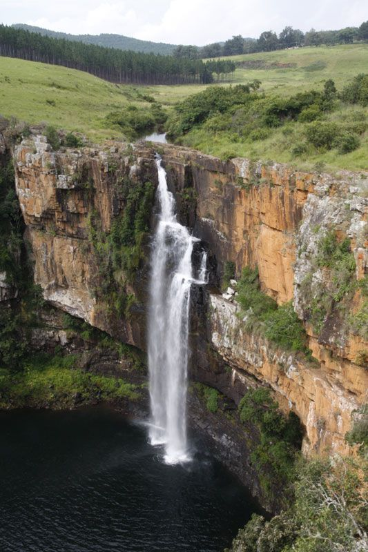 Berlin Falls near Graskop, Mpumalanga, South Africa; on the Sabine River and fall 260 feet, dumping into a circular basin flanked by red cliffs; the falls have the shape of a candle, with the first short drop the wick, and the remaining, broader drop being the candle body; given its name by German gold miners - photo by pj1 (Pierre Joubert), via TrekEarth (but his photo is incorrectly labeled 'Lisbon Falls')