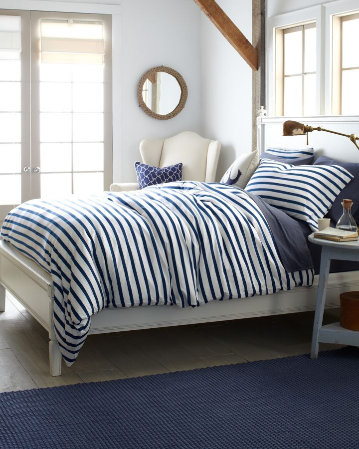 Add a nautical touch to your bedroom with striped jersey knit bedding and beach inspired accents.