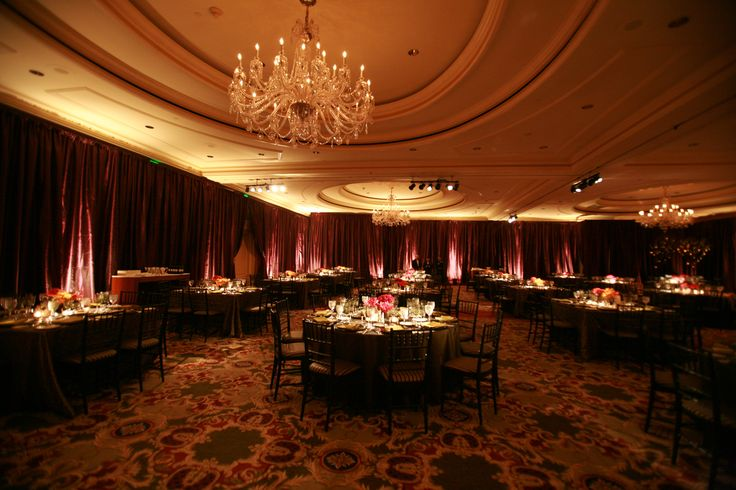 Enhanced Lighting installed Egg Plant Taffeta around the Ritz Carlton SF Ballroom. Candlelit uplighting and table pinspotting created an inviting room for the guests.