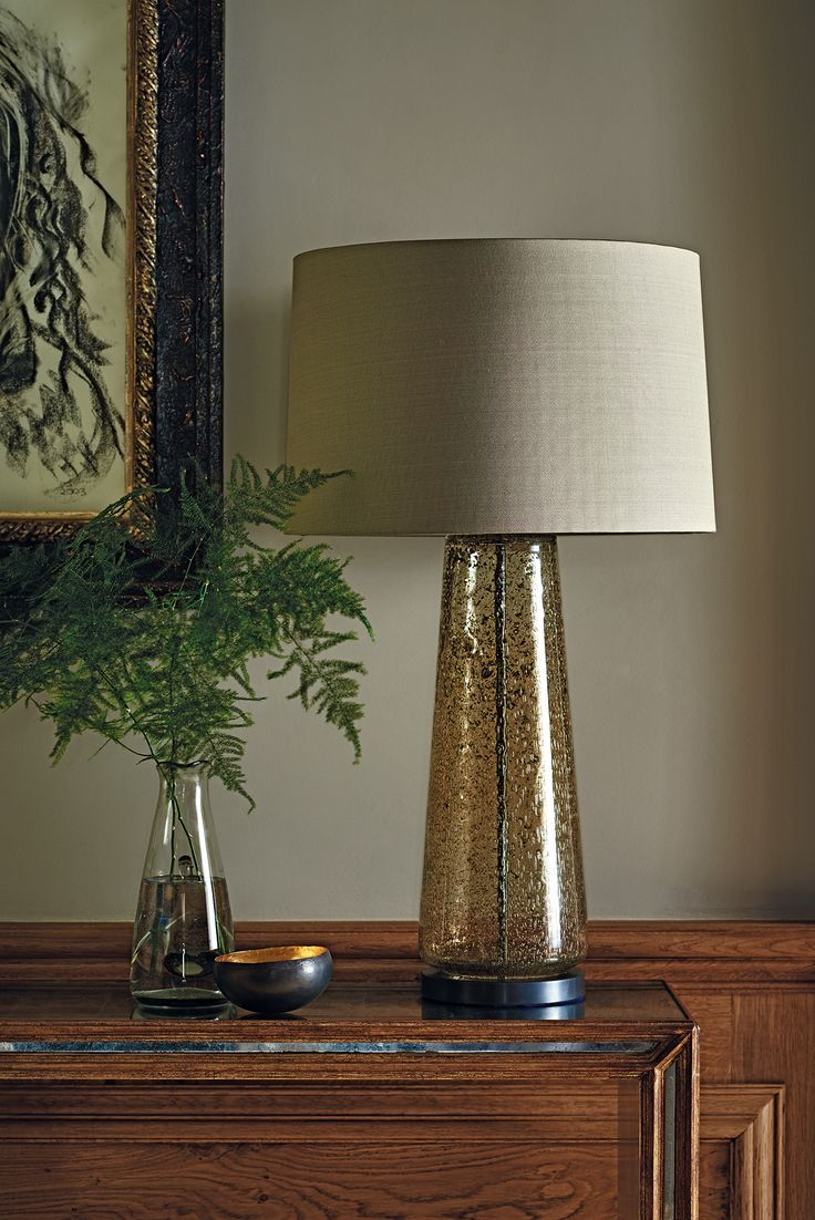CAIUS CHAMPAGNE  The Caius lamp is a beautifully textured, mould blown glass piece. The gentle golden hue and stippled surface effect give the lamp an air of luxury and grandeur. This design is individually crafted and will vary from piece to piece.