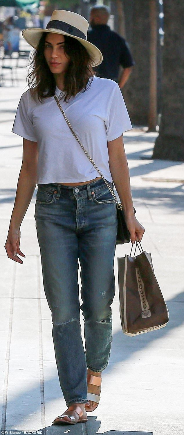 Casual: The 36-year-old wife of actor Channing Tatum flashed a hint of tummy in a cropped white tee paired with distressed  jeans. She completed her ensemble with shiny flat sandals