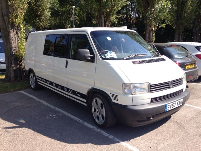 White Volkswagen T4 Transporter tin top camper conversion.