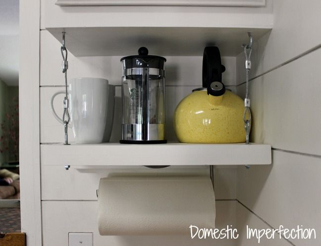 Creating a shelf under your top cabinets - i like this idea, not sure I can pull it off since I have halogen under cabinet lights.