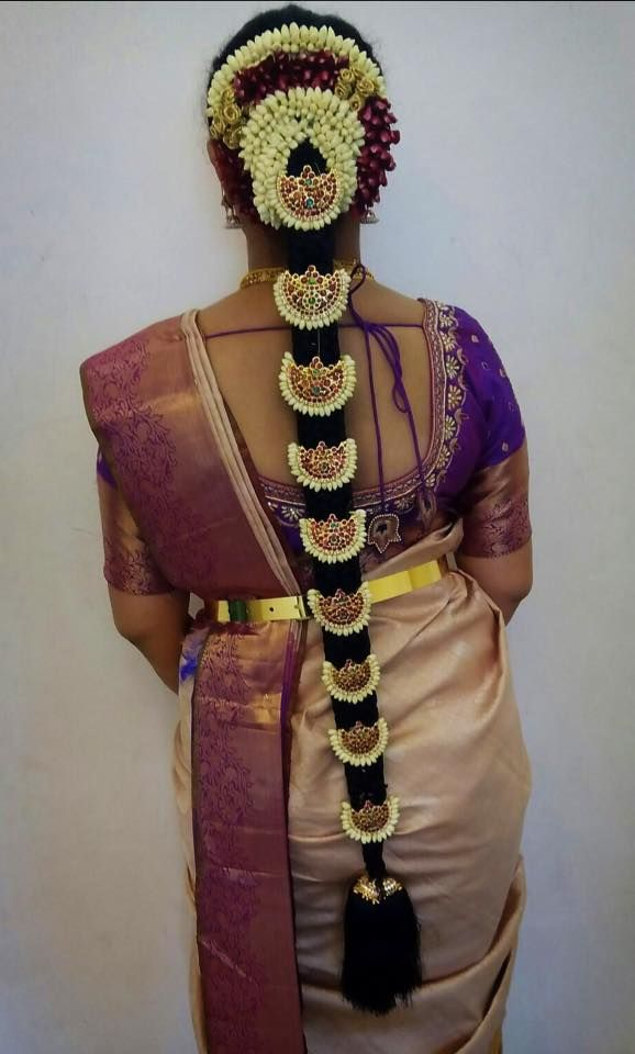 Traditional Southern Indian bride's bridal braid hair. Hairstyle by Swank Studio. #SilkSaree #Blouse #Design #HairAccessory Temple jewelry. Jhumkis. Silk kanchipuram sari. Braid with fresh flowers. Tamil bride. Telugu bride. Kannada bride. Hindu bride. Malayalee bride. Find us at https://www.facebook.com/SwankStudioBangalore