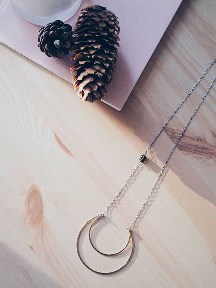 I love that this necklace was handmade into a lunar shape