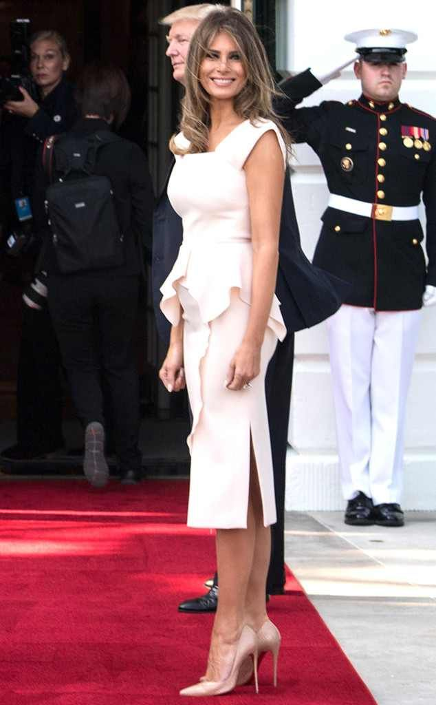 Peplum Power from Melania Trump's Best Looks  The D.C. wife looked cute in cream, wearing a Roland Mouret Sawleigh peplum dress to meet the South Korean president.