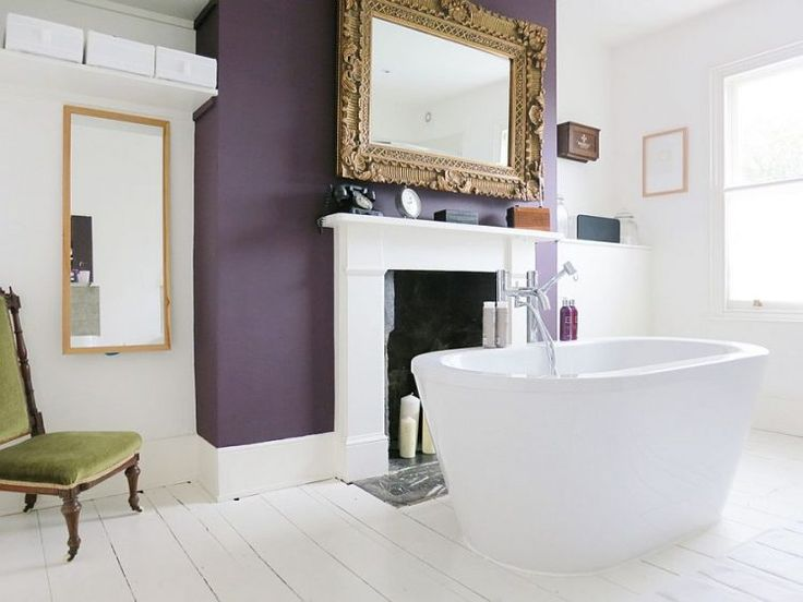 bathroom with purple accent wall