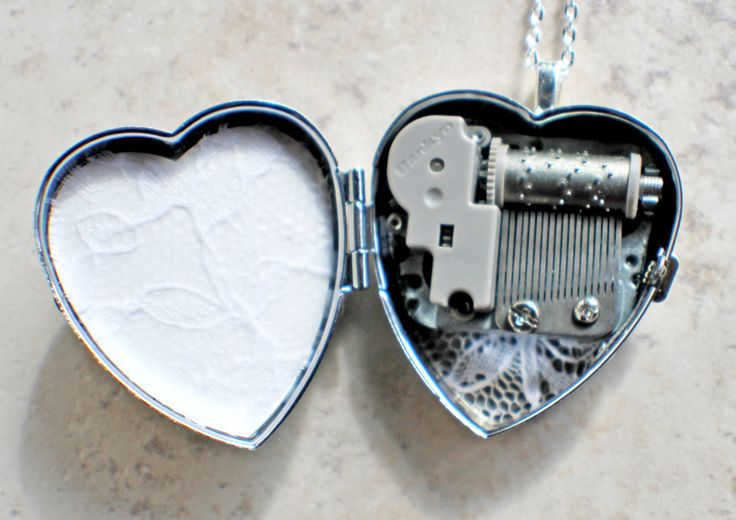 Music box locket, heart locket with music box inside, in silver tone with floral heart, angel wings and dragons breath opal cabochon.