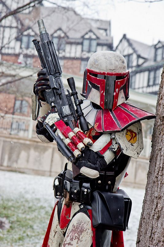 Mandalorian - Snow Mando.   MPAPPS Assault blaster rifle with adjustable scope. Utility belt, no doubt holding a vast array of gadgets, such as a magnetic grappler, vibro cutters, activators, and whatnot. Horns of Doom mark on shoulder guard, just under ranking bandolier. - Geram.