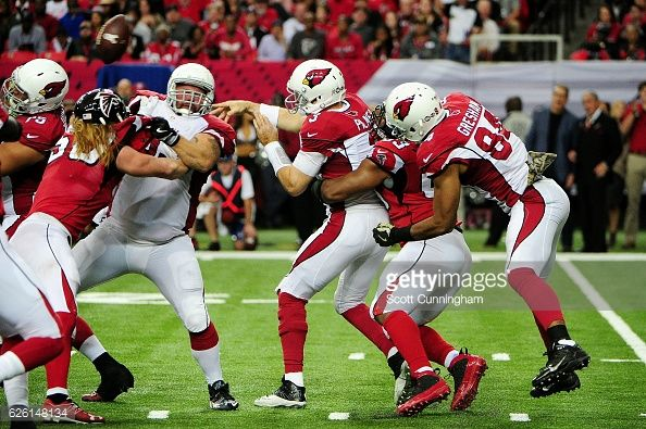 News Photo : Dwight Freeney of the Atlanta Falcons forces an...