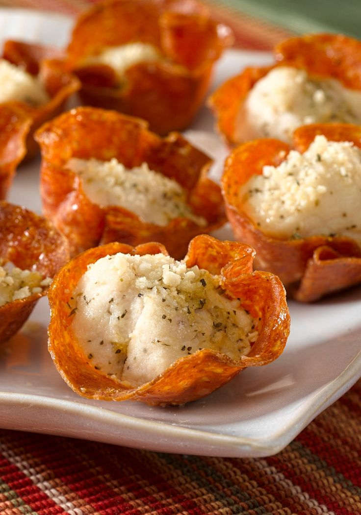 Pepperoni-Parmesan Chicken Bites -- Ready for the oven after just 15 minutes prep, this delicious appetizer recipe is sure to make your next party more delicious!