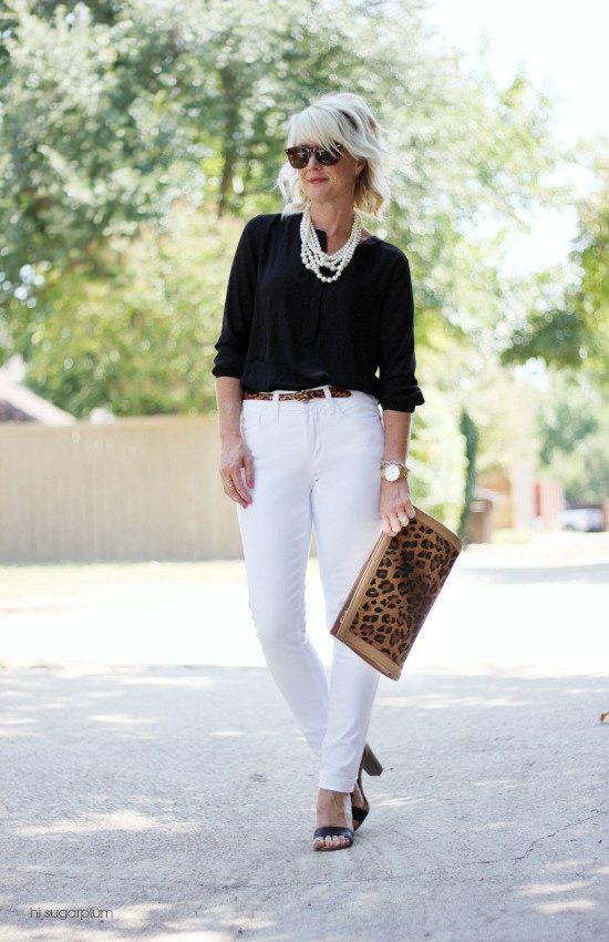 black top statement necklace black heels animal print clutch