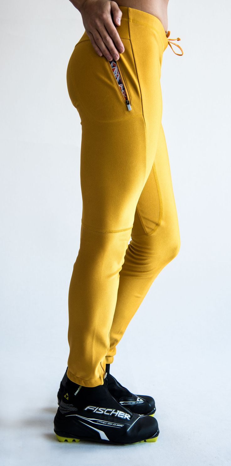 SWEARE XC 360 Pant in the color Yellow spark. It doesn't matter if you go classic- or skate skiing, the pant allows for movement in all directions and won't rip or hinder you and it has excellent breathability and very good water repellency. This pant are perfect for autumn and winter running and of course for XC skiing. All fabrics are manufactured in Sweden and Switzerland from high quality vendors. #älskasnö #vasaloppet #älskaåre #längdskidåkning #running #trailrunning #vinter