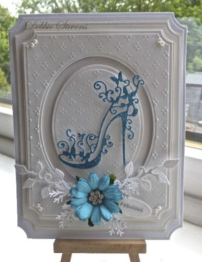 "A lovely handmade card ""Fabulous"" by Debbie Stevens. It has several layers of assorted diecuts. I love the Tattered Lace high heel shoe and the dainty dots embossing folder!  A clean and simple card that is definitely very feminine."