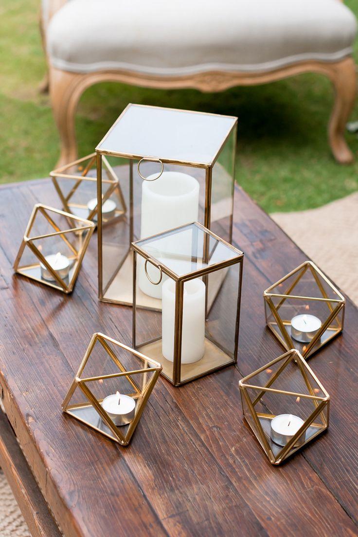 Wedding lounge centrepiece of gold geometric candleholders | Liesl Cheney Photography | See more: http://theweddingplaybook.com/watercolour-garden-wedding-inspiration/