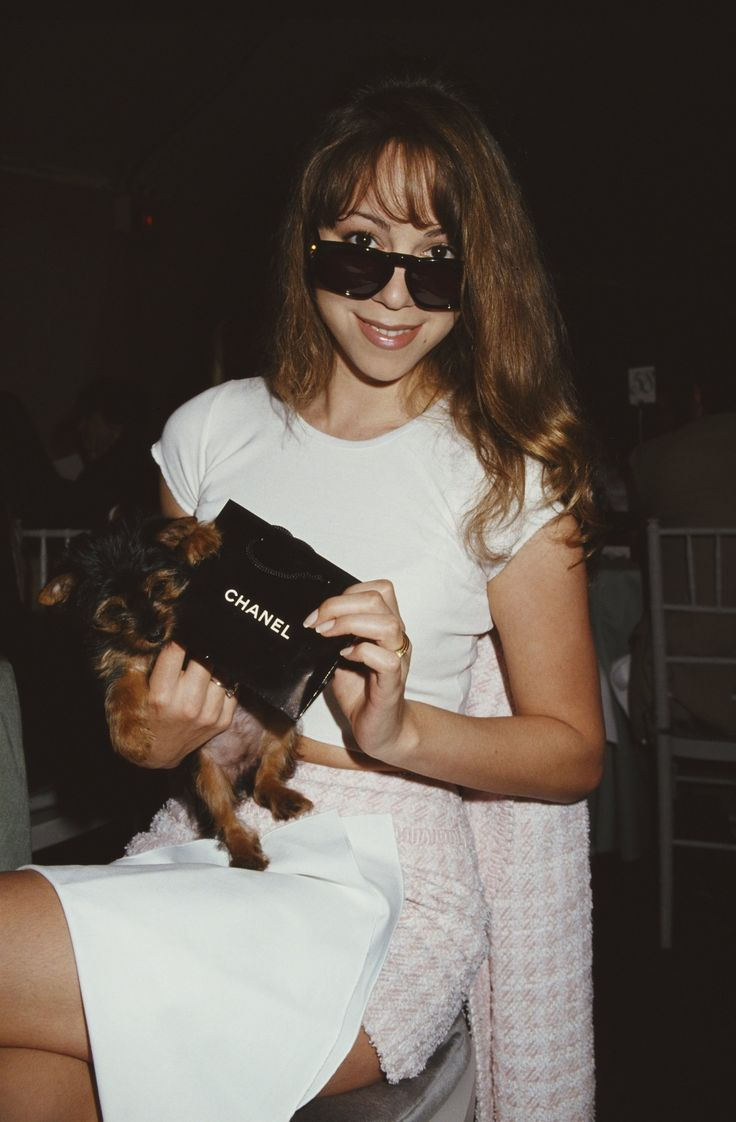 Mariah Carey's sunglasses deflect fluorescent lighting on Mariah World.