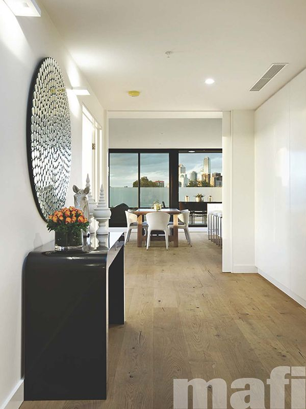Albert Park Penthouse by Mataxas Architects featuring mafi Oak Country Brushed Natural Oil timber floors in hallway and dining area.