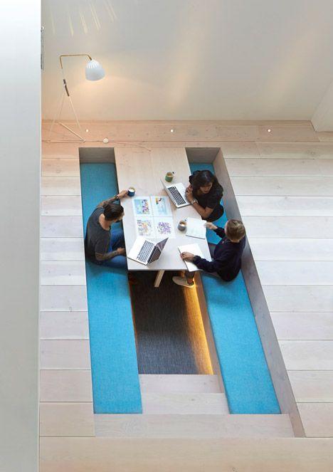 Paul Crofts Studio sinks seating areas into floor of London office.