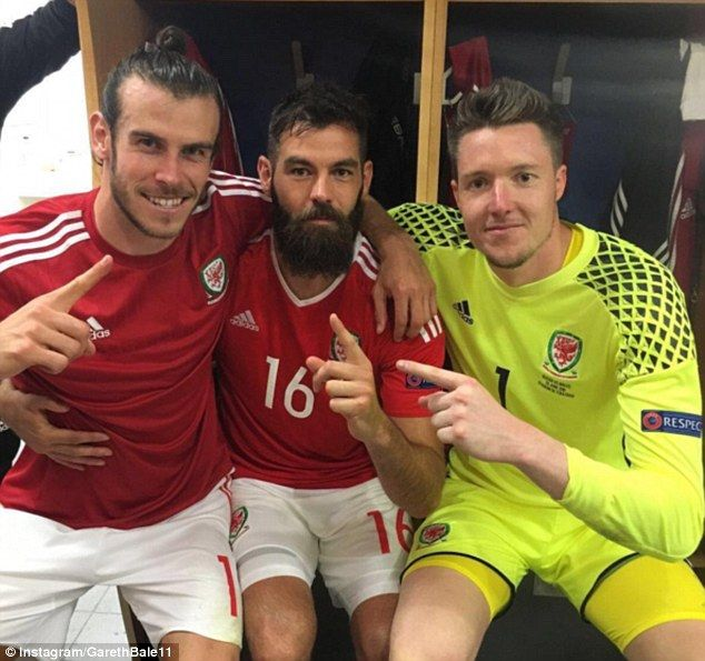 Bale celebrates in the dressing room with Wales team-mates Joe Ledley and Wayne Hennessey