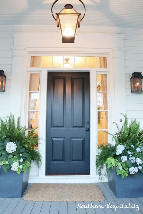 Love these dark grey planters with ferns, hydrangeas and sweet potatoe vine.