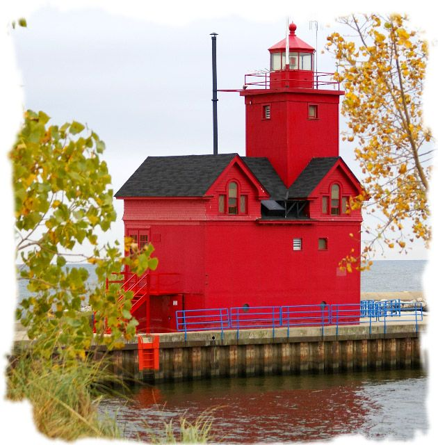 The three-story Holland Harbor light is on Black Lake and was built in 1907. It is covered with red steel to protect it from the heavy pounding it gets during rough weather. The current light tower was added to the top of one gable in 1936. Big Red sits on a pier that runs along the south bank of the channel connecting Lake Macatawa to Lake Michigan.