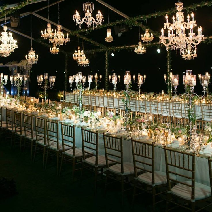 3 Layered Lights with Crystal chandeliers, candelabras centerpiece and tea light and pillar candles below, how more romantic can it be?