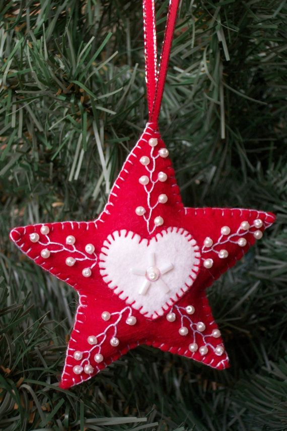 This whimsy star ornament is made with wool felt and craft felt. The star is white & red. They are hand stitched with a 100% cotton red and white embroidery floss. Sequins and glass beads and pearls are added for a splash of sparkle! The are lightly stuffed with poly-fill to make them a little poufy! A 7 metallic trim hanger is attached. These can be used as bowl fillers, door hanger, ornaments for the holidays or added as gift package decoration.  They measure about 4 x 4 before the poly…